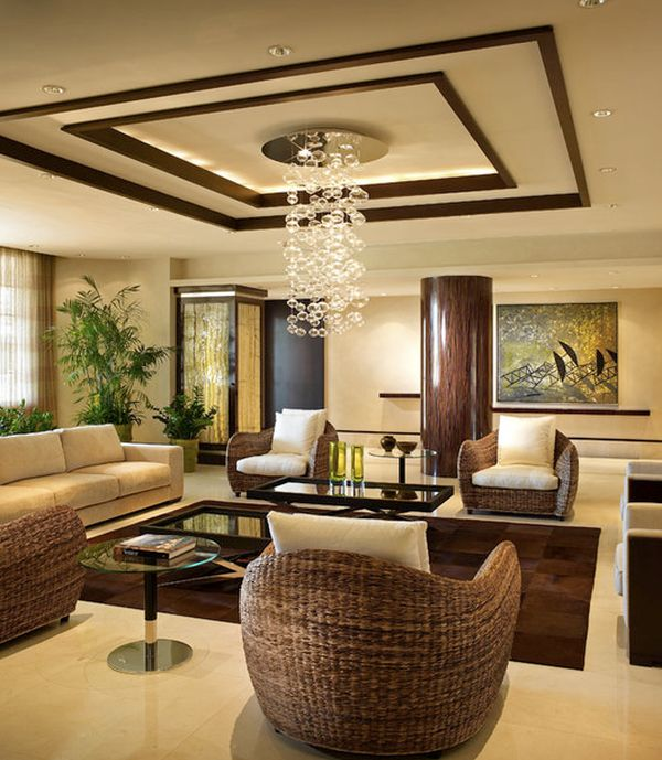 Warm living room with intricate ceiling design and gentle tones. 33 Stunning Ceiling Design Ideas to Spice Up Your Home