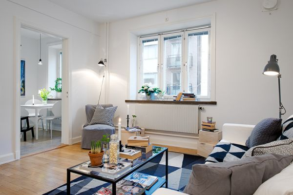Tiny swedish apartment showcases how to decorate small for Styling small apartments