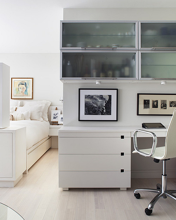 Bright white guests room with small office