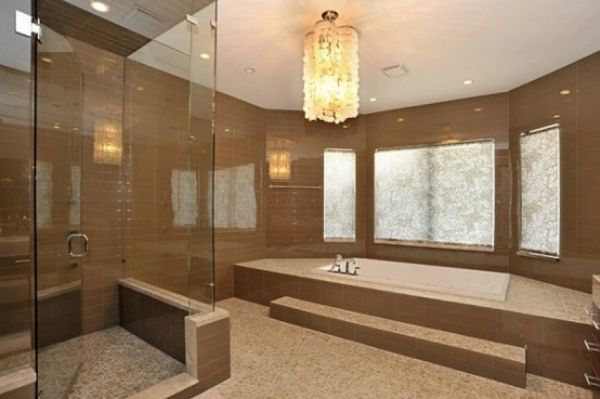 This traditional bathroom features an incredible sunken bathtub and spacious shower.