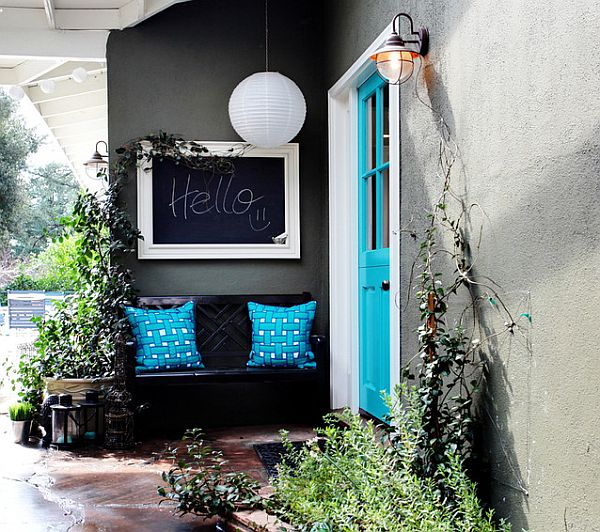 colorful front entry with blue pillows and door How to Bring Spring Colors into Your Front Entry