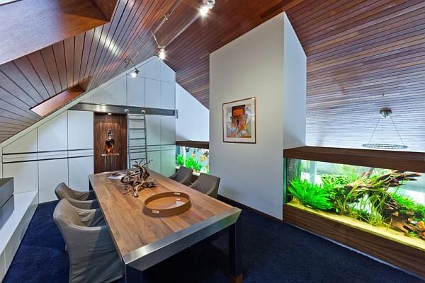 home office with stylish huge aquarium