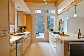 Modern galley kitchen with white countertop and beautiful backsplash