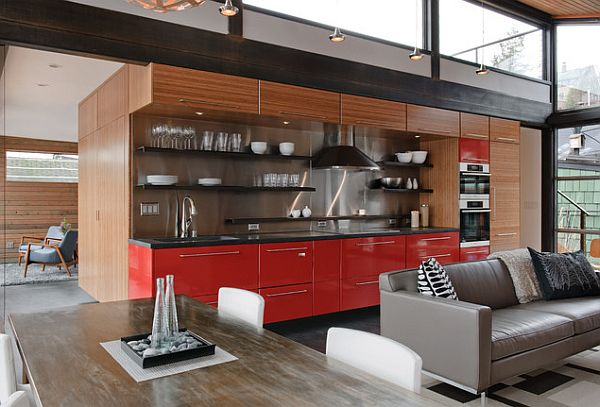 Open plan kitchen design with red cabinets