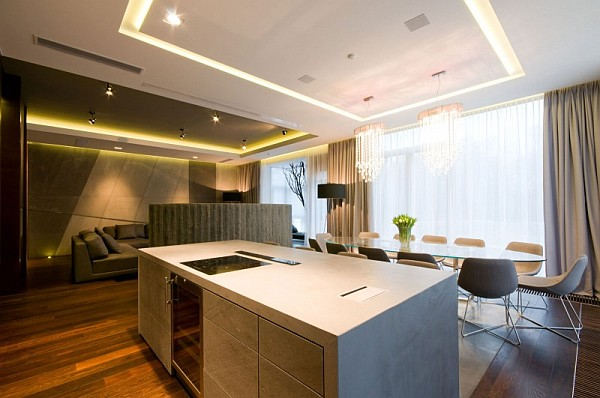 open space kitchen with glass dining table
