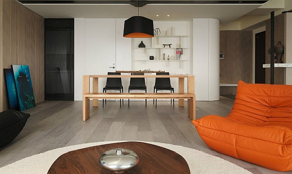 orange couch in modern asian apartment Modern Apartment Plan With Neutral Colors and Bold Accents