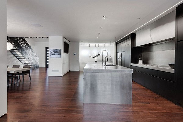 stainless kitchen island and black kitchen cabinets