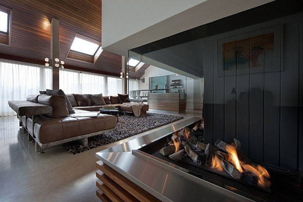 stylish living room with firepit Beautiful Dutch Villa Steals The Show With Giant Aquarium and Lively Colors