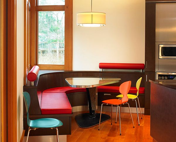 Triangular kitchen table with colorful chairs
