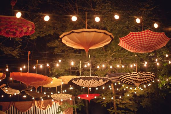 Backyard Party Line Dance : Umbrellas combined with string lights help to set the perfect mood