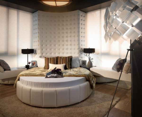 Antique decor and a round bed combine to create a modern bedroom