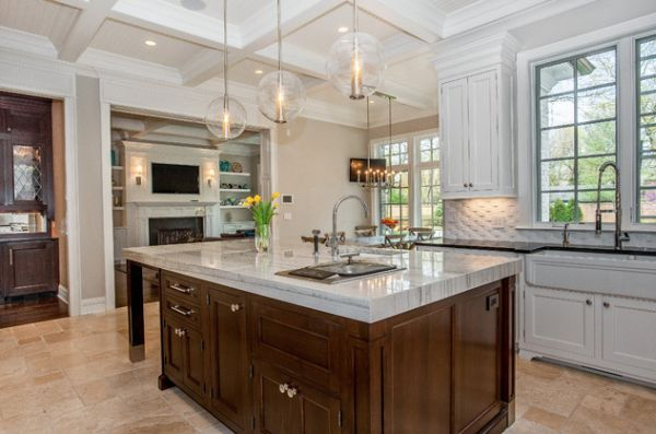 Arteriors Caviar Pendant lights offer a gorgeous textural and visual contrast to this kitchen in Chicago