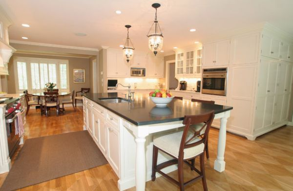 View In Gallery Artistic Hampton Pendant Lights Above This White Kitchen Island With Dark Countertop