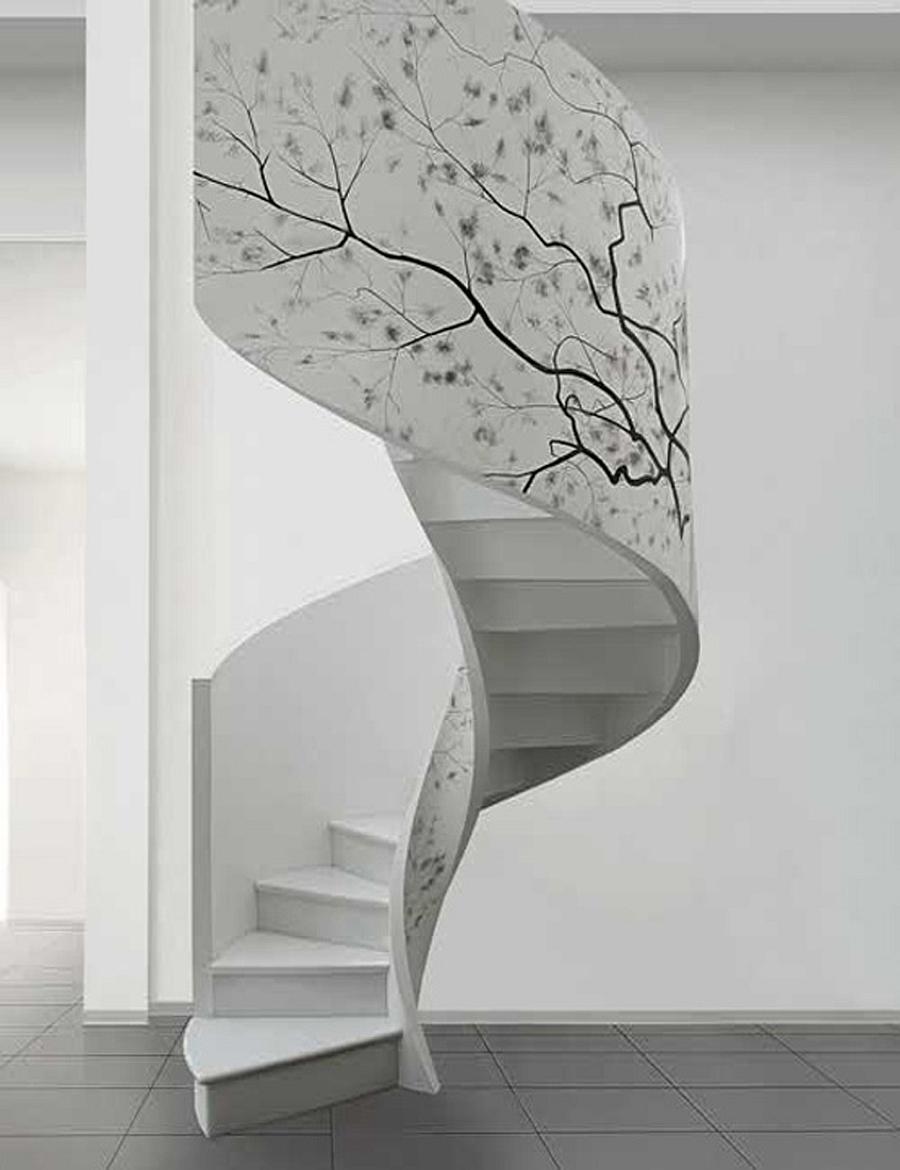 Artwork enlivens the white spiral staircase