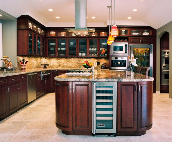 Beautiful cherrywood cabinets complement the glass door refrigerator perfectly