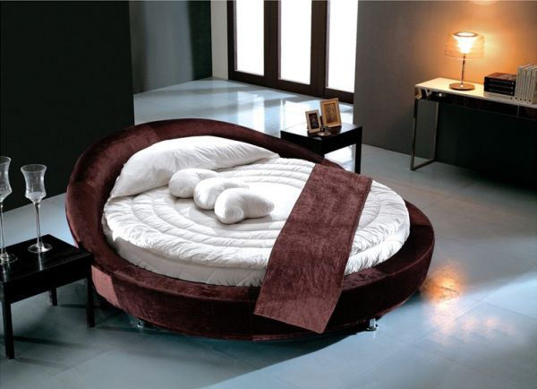 Beautiful modern bedroom with a stylish round bed 27 Round Beds That Will Spice Up Your Bedroom
