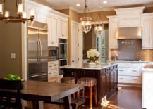 Beautifully-illuminated-kitchen-sports-a-couple-of-cool-pendant-lights-217x155
