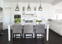 Benson pendant lights bring an antique touch to this modern white kitchen