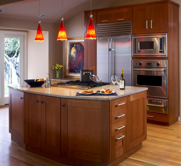 55 beautiful hanging pendant lights for your kitchen island view in gallery bright red pendant lights offer a vivid contrast to this largely neutral kitchen aloadofball Images