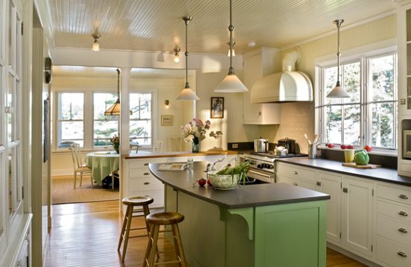kitchen space with green hues and low hanging pendant lighting