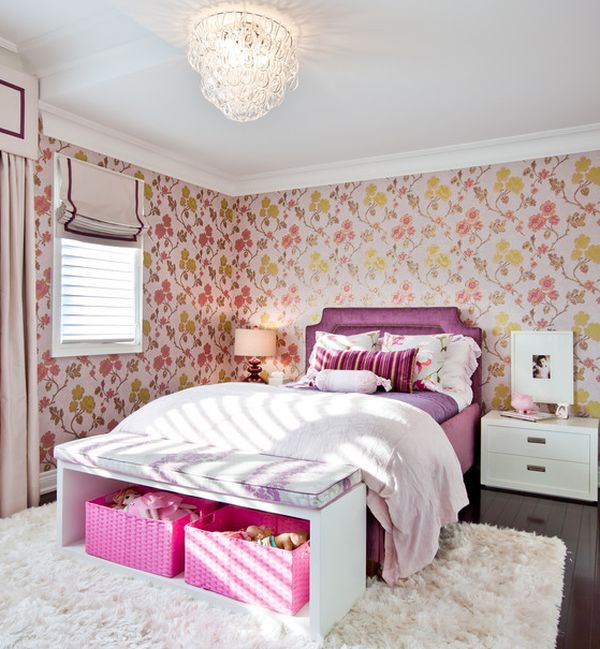 Chic girls' bedroom in pink with a beautiful bench that hides pink storage baskets with ease