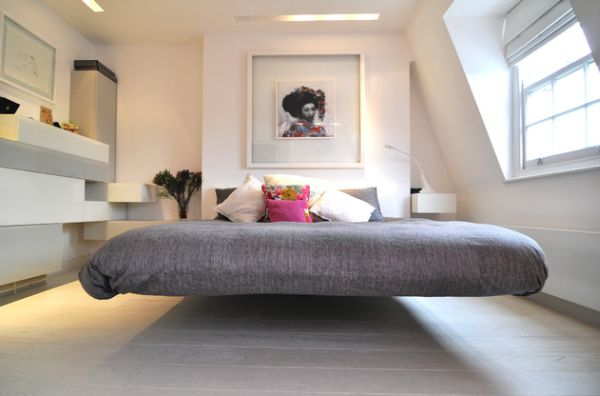Chic modern bedroom with a cool floating bed draped in gray