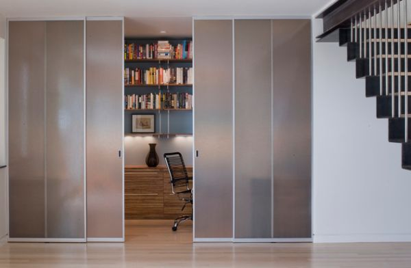 Closet-styled frosted glass doors to tuck away home office space