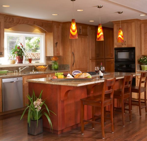 Colorful pendant lights accentuate the red and yellow hues in the kitchen