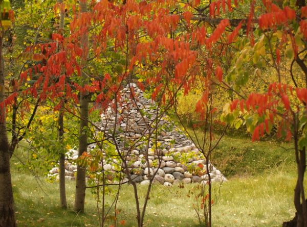 Cone of stones tucked away beautifully in bright red foliage can be appealing art pieces as well