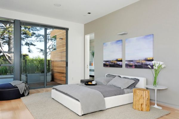 Contemporary bedroom in neutral tones sports sliding glass doors
