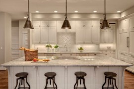 Contemporary kitchen with Darien Metal Pendants over the kitchen island