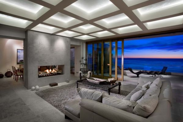 Contemporary living room with sliding glass doors offers a spectacular view outside