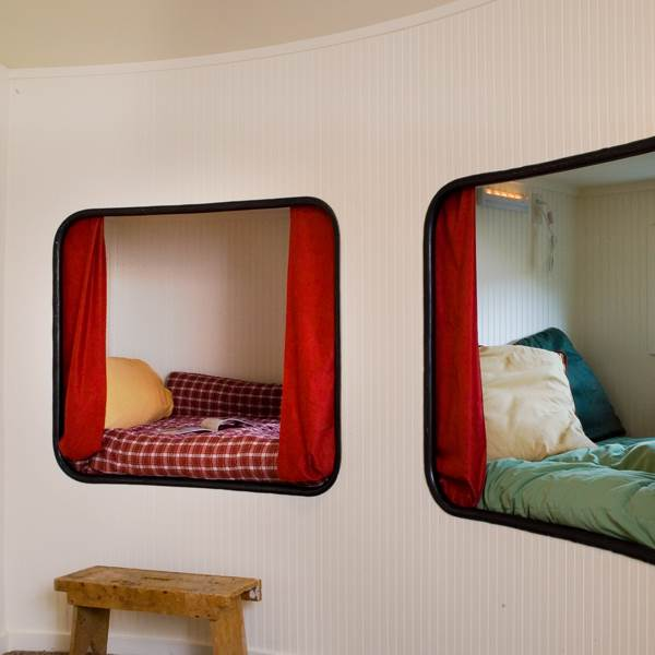 Cozy bunks in a silo house