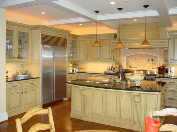 Custom designed kitchen island with pendant lights bring in a classic appeal