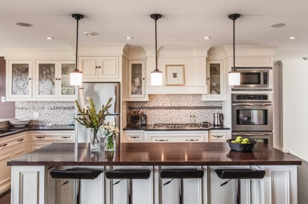 55 beautiful hanging pendant lights for your kitchen island view in gallery dazzling pendant lights above a white kitchen island with dark granite top aloadofball Image collections