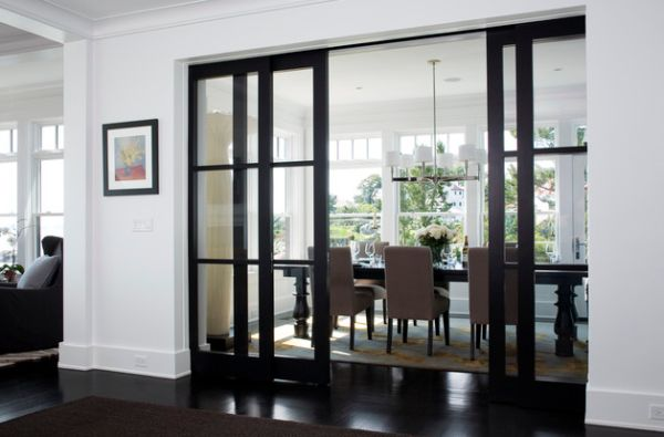 View In Gallery Elegant Dining Area Concealed By Sliding Glass Doors Wooden Frame