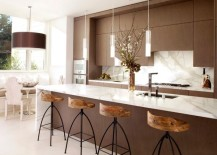 Exquisite modern kitchen in white and brown with sleek pendant lights above the kitchen island 217x155 55 Beautiful Hanging Pendant Lights For Your Kitchen Island