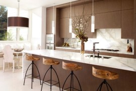 Exquisite modern kitchen in white and brown with sleek pendant lights above the kitchen island 270x180 55 Beautiful Hanging Pendant Lights For Your Kitchen Island