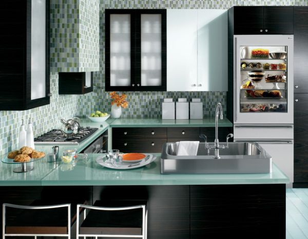 Fabulous kitchen in blue and green with a 30-inch wide integrated glass door refrigerator