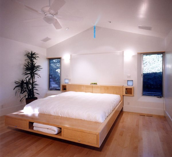 Floating bed design with storage units underneath
