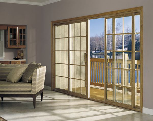 Four Panel sliding glass door in with sqaure grids creates a timeless look