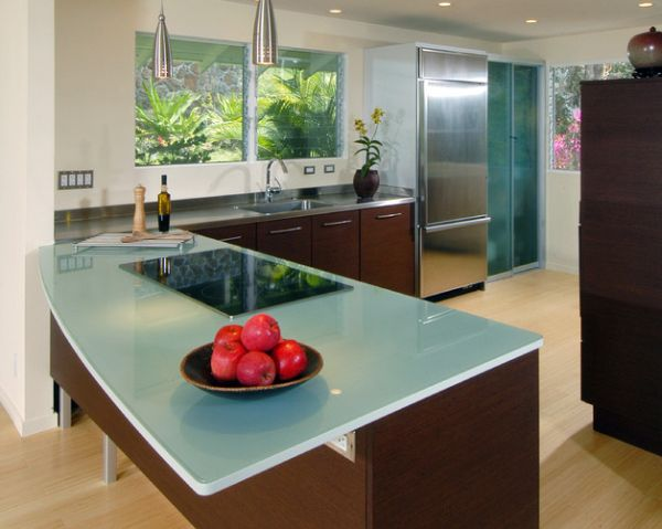 Glass countertop and pendant lights with metallic tinge for a stylish contemporary kitchen