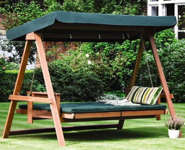 Gorgeous green swing bed in the backyard with shade