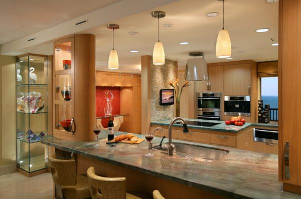 Gorgeous modern kitchen with beautiful use of pendant lights