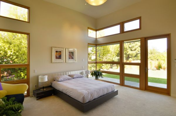High ceiling and accents of wood add to the beauty of this master bedroom