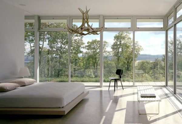Interesting chandelier and ample views surround this floating bed