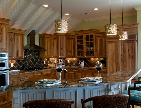 L-shaped kitchen island lit gorgeously using Alita pendant lights