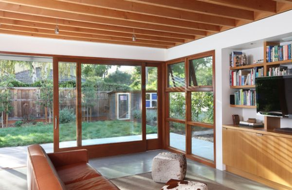 Large sliding glass doors within a wooden frame