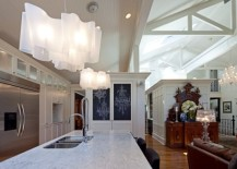 Logico-Pendant-Lights-over-the-kitchen-island-look-like-floating-pieces-of-modern-art-217x155
