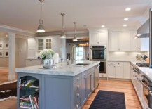 Long-kitchen-island-with-marble-countertop-lit-up-using-Benson-pendant-lights-217x155